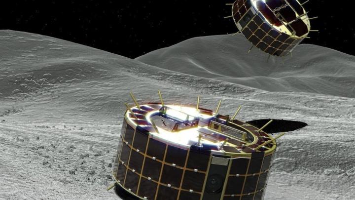 Ilustração dos robôs no asteroide Ryugu