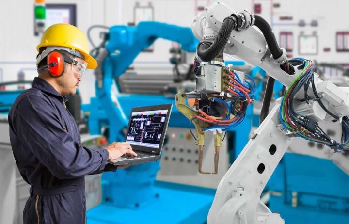 Imagem de robôs a trabalhar na indústria