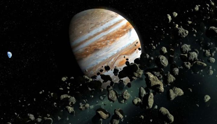Imagem de Júpiter rodeado pela cintura de asteroides que poderão ter a Terra como alvo