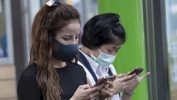 Imagem China em alerta por causa do coronavírus. Avisos nos smartphones Xiaomi