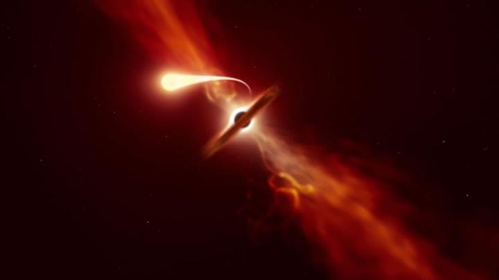Ilustração da imagem captada do último suspiro de uma estrela devorada por um buraco negro