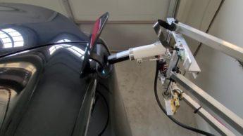 Imagem robô de carregamento automático de um elétrico Tesla